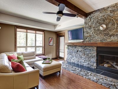 Canyon Ridge's living area, Rundle stone dual sided gas fireplace, TV, DVD & Wii