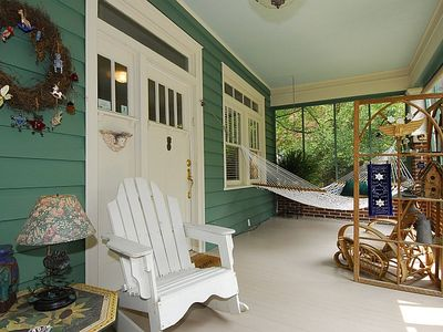 Screened front porch with hammock and dining area