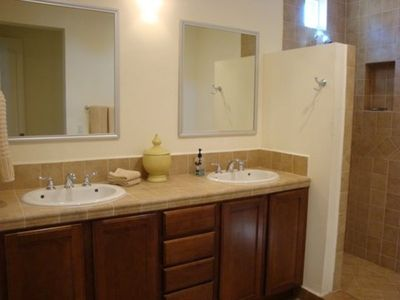 Master bath with double sinks, walk in shower and soaking tub