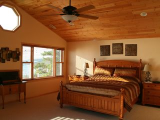 Mackinaw City house photo - Spacious Master Suite with privacy and lake views.