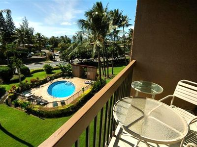 View of the grounds and the pool from the lanai. Enjoy a cool drink at sunset.