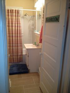 Downstairs full bath: tub/shower, large stocked linen closet, New tile April '13