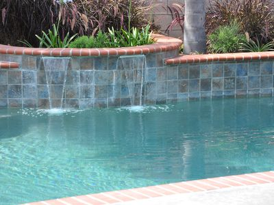 Cascading Waterfall in Pool Solar and gas heated pool. Warm all year long.