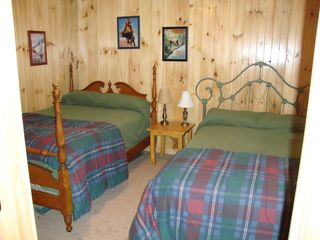 Ludlow chalet photo - Bedroom have knotty pine for that cozy cabin feel with sleeping for 12!