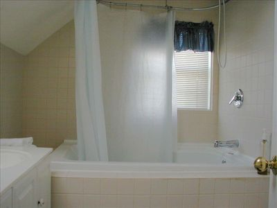 Master with whirlpool tub & shower; 2 sinks, wall mt. cosm. mirror & hair dryer