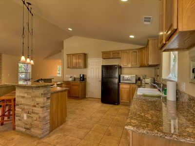 Beautiful kitchen with granite counters and new appliances!