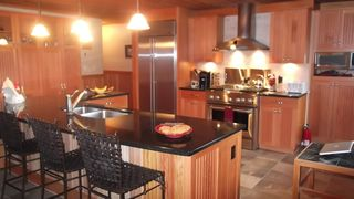 Lake Placid property rental photo - Spacious kitchen, with large window overlooking Paradox Bay