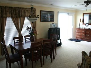 Surfside Beach house photo - Dining on lower level. To the left of table is a full kitchen w/ all appliances