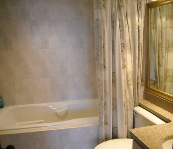 Englewood townhome rental - Master bath air jetted tub and granite countertops