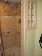 Manchester house photo - This is the Master accessible roll in tile shower!