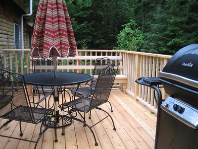Deck with bench, gas grill, and comfortable dining
