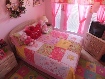 PRINCESS ROOM WITH TV STUFFED ANIMALS AND A CEILING FAN