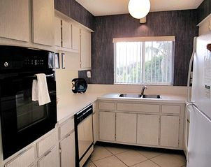 Sanibel Island condo photo - Updated kitchen with convenient bar area