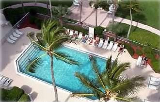 Lanai overlooks the great pool, nice large lawn next to great beach, for both un