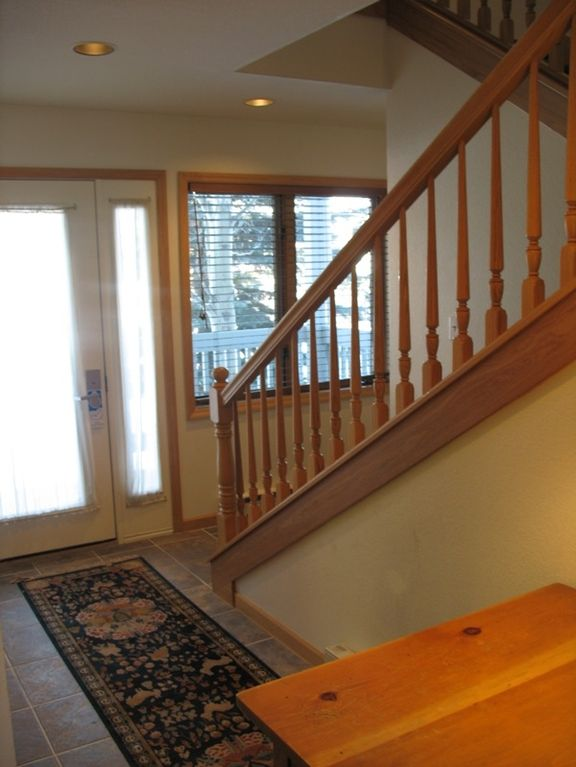 Foyer & stairs leading to upstairs living area and master bedroom.
