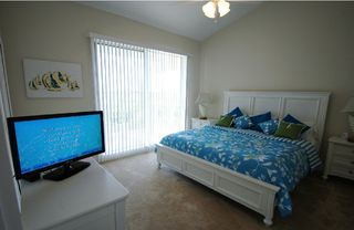 Tampa townhome photo - Master bedroom 1 king bed, LCD-TV, Balcony with table & chairs,view of Tampa Bay