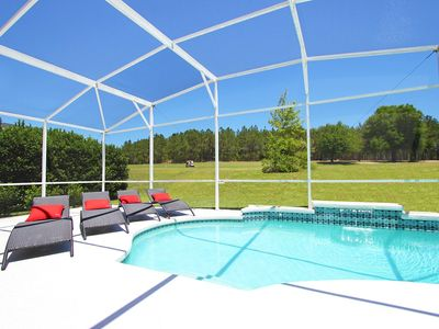 Pool with Contemporary Furniture & overlooking Golf Course