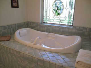Couple's romantic jet tub in master suite - Montgomery Estates house vacation rental photo