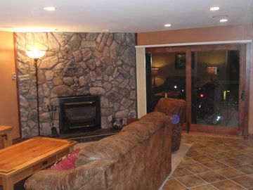 Moss Rock Gas Fireplace and Balcony Door