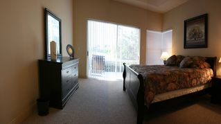 Vacation Homes in Marco Island house photo - King size Bed and doors to the Lanai