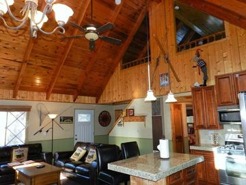 Big Bear Lake cabin rental - Pine Cone Alley interior w/loft above. (Is that a moose on skis?)