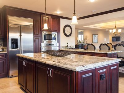 Upgraded kitchen with granite and marble