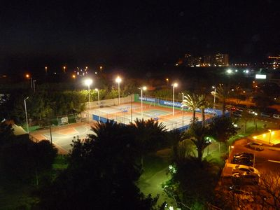 View on the tennis court by night from the apartment