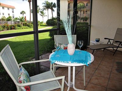 Screened Lanai with views of the Gulf and the Pool