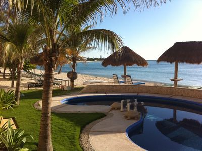 View from our living room and patio, the Caribbean Sea and crystal clear pool.