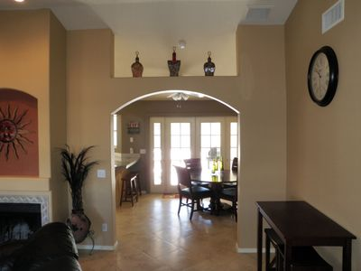 ARCH WAY TO DINNING ROOM AND KITCHEN