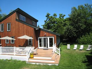 Hampton Bays house photo - Back of the house with brand new deck and added sun room on right of main area