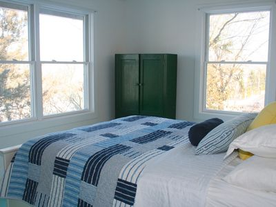 Queen bedroom with attached bath has lake views