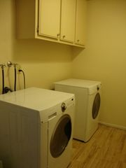 Las Vegas house photo - .laundry room front loader washer & dryer