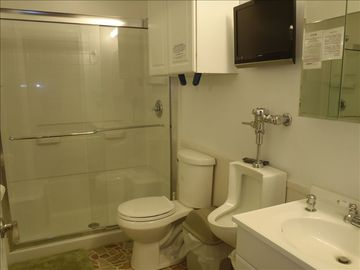 Just off Great Room, Hall Bath is for the 2 private rooms