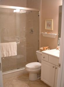 Large bathroom with dual shower heads