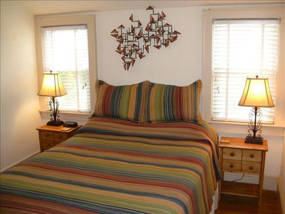 Queen Bedroom has two windows with views of the ocean and our private sand dune
