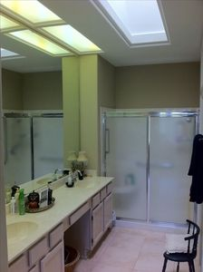 Ensuite Master Bath with double sinks, walk-in shower and separate toilet room
