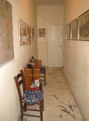 Trastevere area condo photo - The hallway has bulletin boards, guide books, and maps for your Rome adventures.