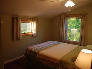 Green room with queen bed over looking pine cove & woods - Alexandria Bay cottage vacation rental photo
