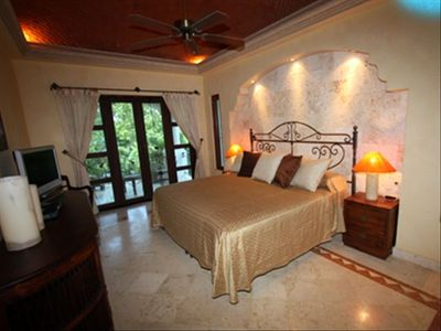 Elegant decor and comfort await you in the Master Bedroom