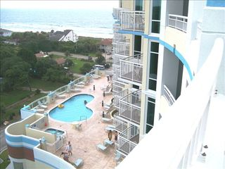 Horizon condo photo - Outdoor heated pool & ocean from 6th floor sundeck