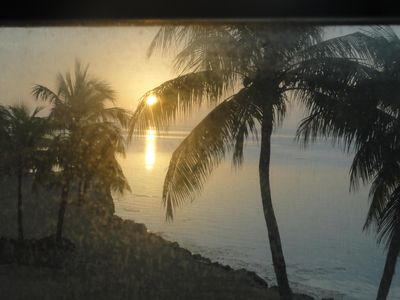 sunrise through the balcony screen.