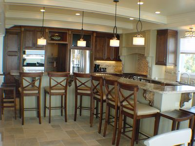 Gourmet kitchen with adjacent butlers pantry