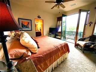 Santa Fe townhome photo - Master Bedroom suite with french doors to outdoor balcony. Beautiful Art.