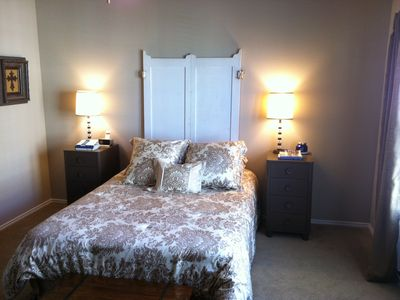 Queen bed and mattress topper in master bedroom.