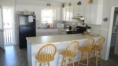 Kitchen and Counter with Stools