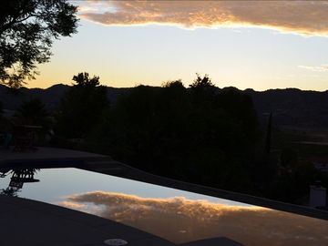 Enjoy dramatic sunsets from either the pool or hot tub.