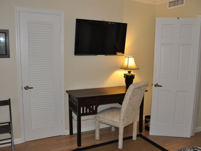 "Guest Bedroom with Twin Beds, Desk, 47"" TV and Double Closets"