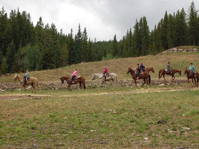 Horseback riding viewed from the patio