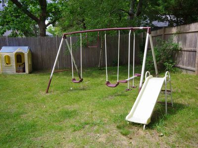 Swing/slide set and playhouse provide entertainment to younger children.